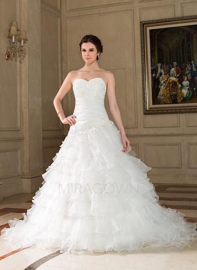 élégante perlante mère de robes de mariée