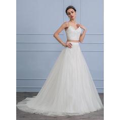 la mère qui coule des robes de mariée