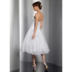 une ligne avec des robes de mariée manches