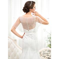 robes de mariée en dentelle serrée