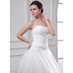visa mig bilder på bröllopsklänningar