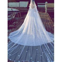 beskrivningar av bröllopsklänningar med bilder