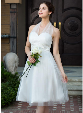 A-Line/Princess Halter Knee-Length Charmeuse Tulle Wedding Dress With Ruffle Lace Bow(s)
