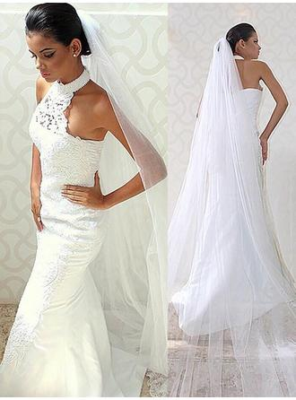 Trumpet/Mermaid Halter Sweep Train Wedding Dress With Lace Beading