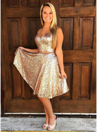 A-Line/Princess V-neck Knee-Length Sequined Homecoming Dresses With Ruffle