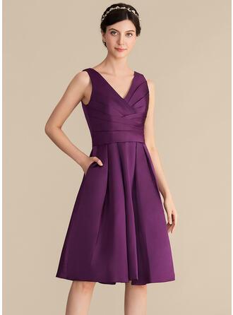 A-Line/Princess V-neck Knee-Length Satin Bridesmaid Dress With Ruffle Pockets
